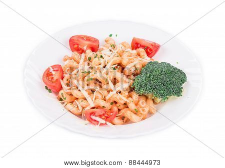 Italian pasta with broccoli and tomatoes.