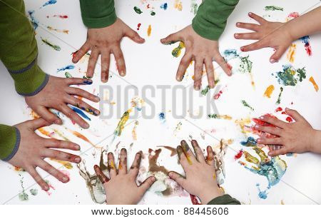 Colorful children hand print on the wallpaper