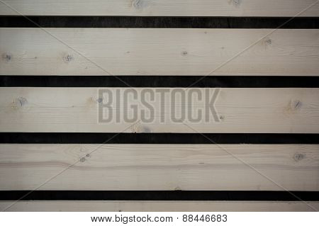 Wall Of Light Wooden Planks With Gaps