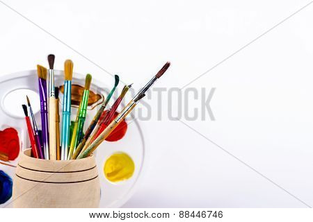 brush with paint pallete isolated