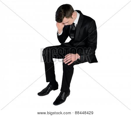 Isolated business man sad looking down