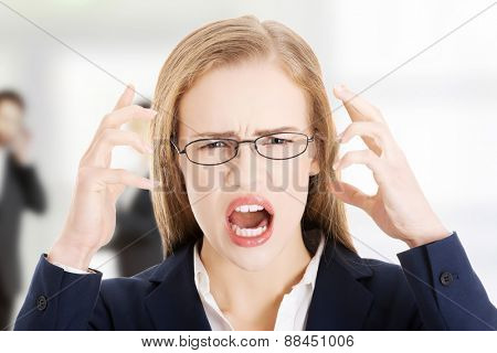 Angry and frustrated business woman yelling.