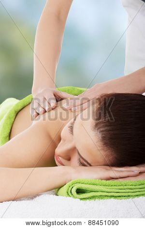 Relaxed woman recieving a massage.