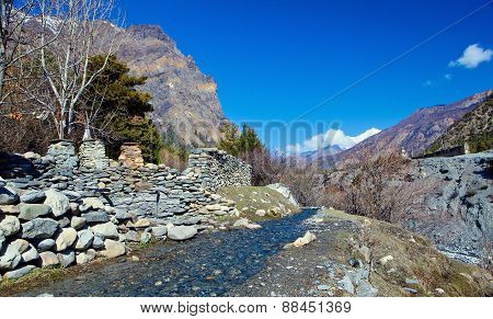 landscape with creek and mountains