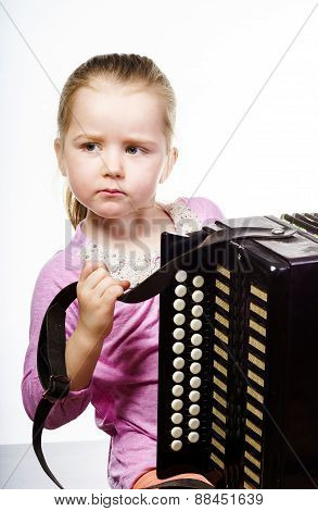 Cute Little Girl Playing Harmonica, Music Education Concept