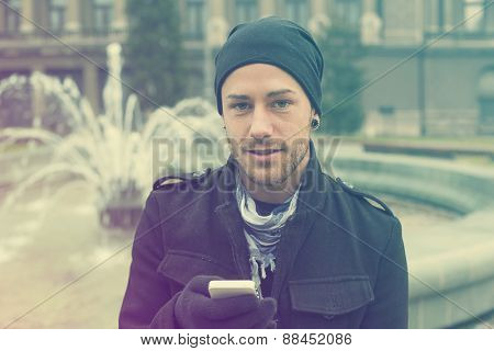 Traveling Man With Mobile Phone And Hat In City, Urban Space