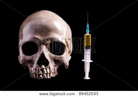 Skull And Syringe Of Yellowish Liquid