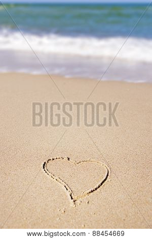 Heart In Sand On The Beach
