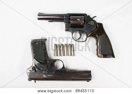 Black Revolver Gun And Semi-automatic 9Mm Gun On White Background