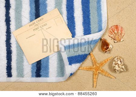 Seashore Background With Starfish And Towel