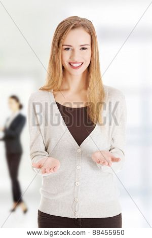 Happy woman showing her empty hands.