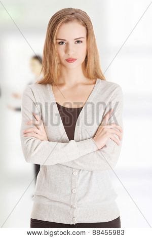 Serious woman with crossed arms.