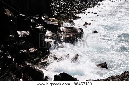 Waves Crash Against The Rocky Bank