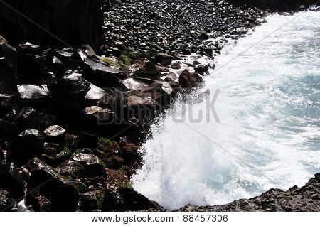 Waves Crash Against The Rocks