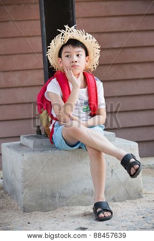 Asian Bored Red Child Is Thinking While