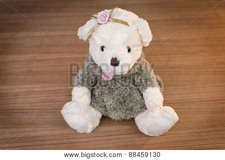 Toy Teddy Bear On Wooden Background