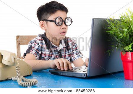 Little Boy Using His Laptop