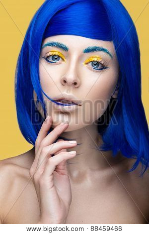 Beautiful girl in a bright blue wig in the style of cosplay and creative makeup. Beauty face.