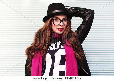 The Stylish City Girl In Sunglasses Shows A Fashionable Look