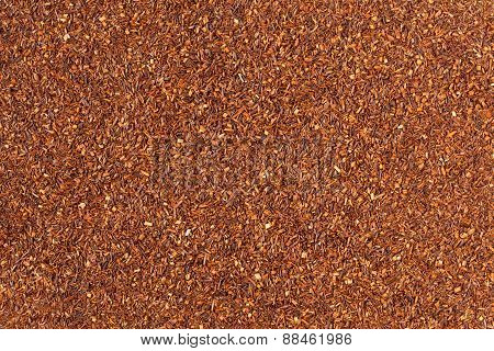 Healthy superfood traditional raw red rooibos tea background texture