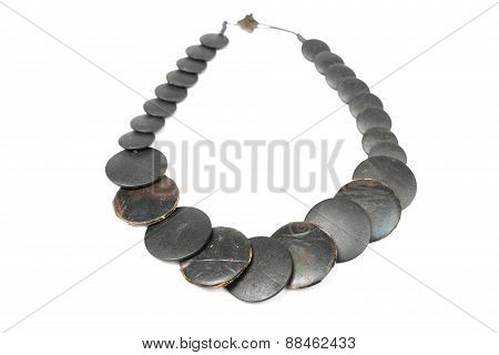 Close Up With A Black Necklace Isolated