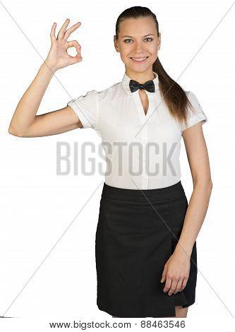 Waitress showing sign okay and looking at camera