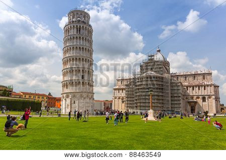 PISA, ITALY - APRIL 11, 2015: People at the Leaning Tower of Pisa in Italy. Pisa is a city in Tuscany known worldwide for the Leaning Tower, one of the biggest landmark.