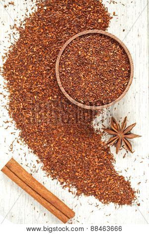 Organic red rooibos tea with spices in wooden mug