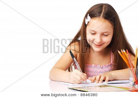 Smiling Little Girl Writing Something.