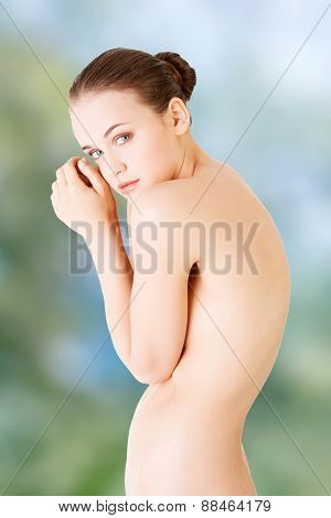 Beautiful shy spa woman with fresh skin.