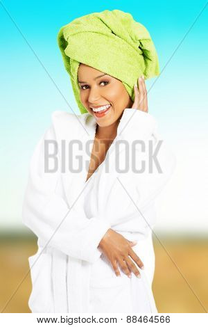 Beautiful woman in bathrobe and turban.
