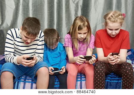 Children Playing Game On Mobile Phones