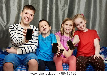 Happy Children Show Mobile Phones