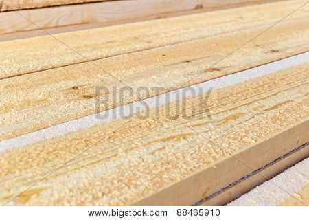 pile of cut wood for construction texture background pattern