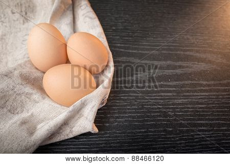 Chicken Brown Eggs In Sackcloth On Wooden Background