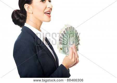 Portrait businesswoman holding a clip of polish money.