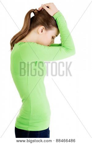 Side view of young depressed woman.