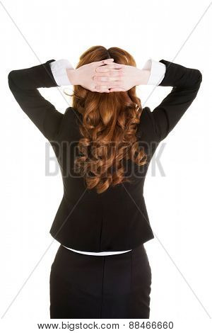 Back view woman having neck pain holding head.