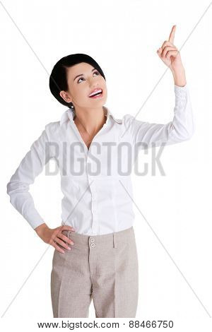 Businesswoman pointing up to the corner.