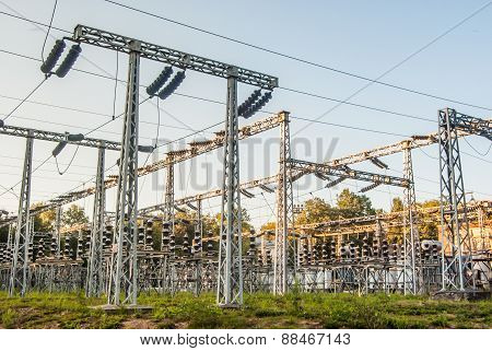 Impression network at transformer station in sunrise