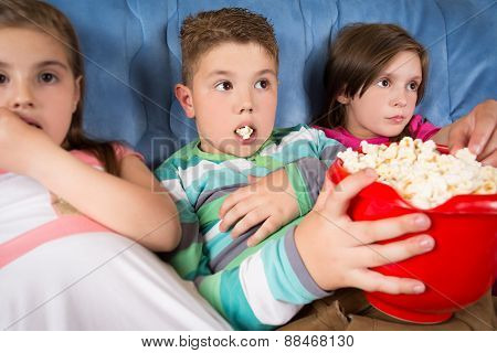 Happy children watching movie at home