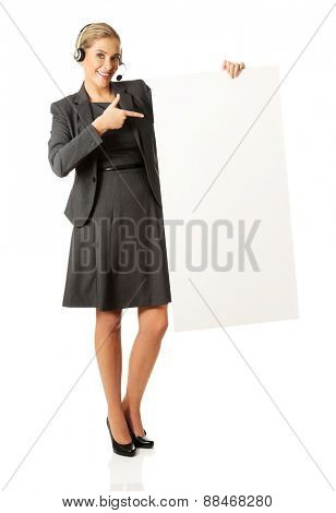 Call center woman with headset holding empty blank
