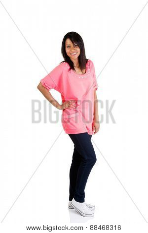 Full length woman posing with hand on hip.