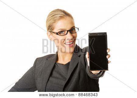 young african american woman presenting smart phone over white background