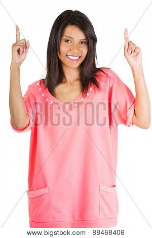 Portrait of happy woman pointing up.