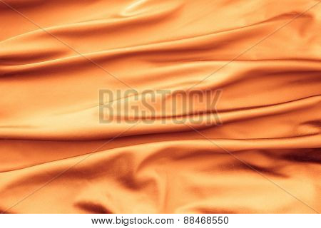 Soft Velvet Piece Of Orange Fabric With Folds