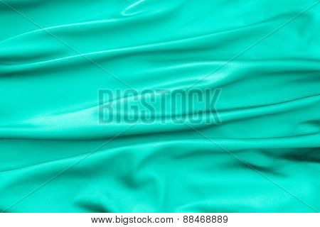 Soft Velvet Piece Of Cyan Fabric With Folds