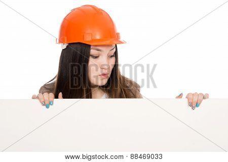 Girl Builder In Helmet Looking At A Blank Banner