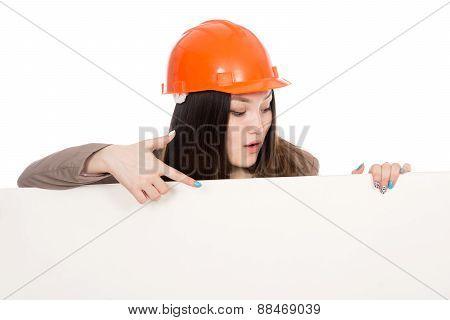 Girl Builder In Helmet Showing A Finger On A Blank Banner.