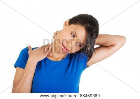 Young woman suffering from neck pain.
